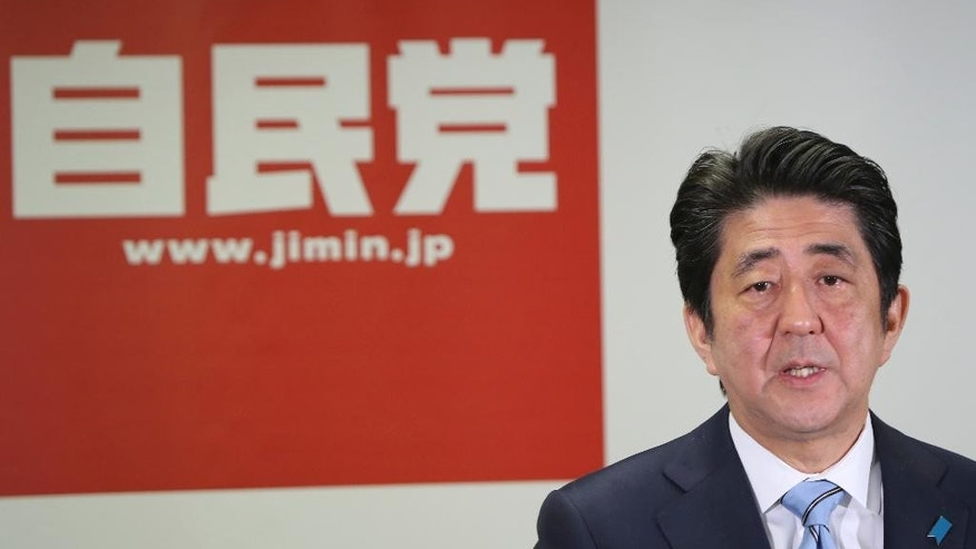 Japanese Prime Minister and leader of the ruling Liberal Democratic Party,  Shinzo Abe speaks during a press conference in Tokyo, Monday, Dec. 15, 2014. With a decisive victory last weekend in an election he forced by dissolving the lower house, the 60-year-old Abe has reaffirmed his hold on power. (AP Photo/Koji Sasahara)