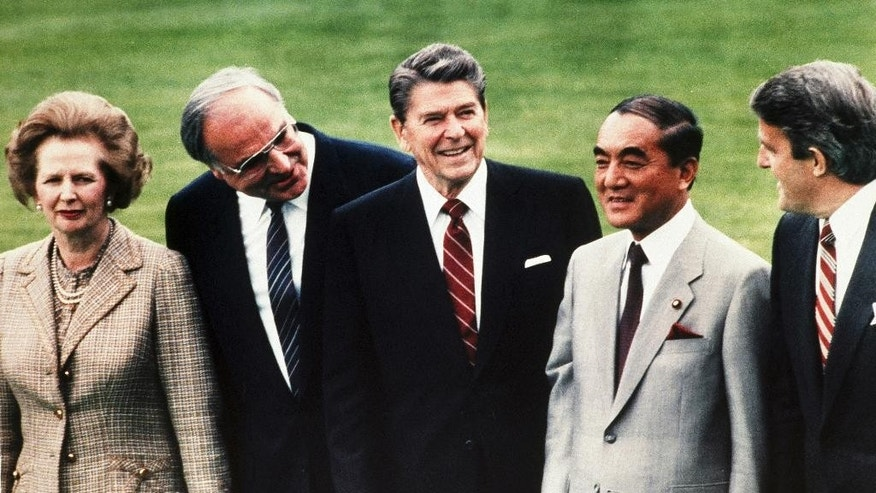 FILE - In this May 3, 1985 file photo, Japan's Prime Minister Yasuhiro Nakasone, second right, stands with British Prime Minister Margaret Thatcher, left, West German Chancellor Helmut Kohl, second left, U.S. President Ronald Reagan, center, and Canada's Prime Minister Brian Mulroney as they pose for a group photo during the World Economic Summit in the garden of Palais Schaumburg in Bonn. Most Japanese prime ministers come and go, their names soon forgotten. Nakasone was an exception in the 1980s as well as Junichiro Koizumi in the early years of this century. Now, Shinzo Abe could be emerging as one of the rare strong ones. (AP Photo/File)