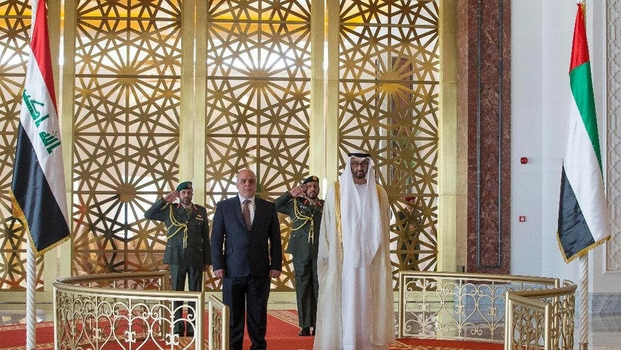 In this image released by the Emirates News Agency, WAM, Iraqi Prime Minister Haider al-Abadi, foreground left, meets with Sheikh Mohamed bin Zayed Al Nahyan Crown Prince of Abu Dhabi and Deputy Supreme Commander of the UAE Armed Forces in Abu Dhabi, right, United Arab Emirates, Monday, Dec. 15, 2014. (AP Photo/WAM)