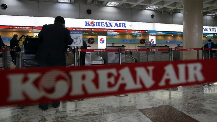 A Korean Air logo is seen at its domestic ticketing counter at Gimpo Airport in Seoul, South Korea, Tuesday, Dec. 16, 2014. South Korea's transport ministry said Korean Air Lines Co. will face sanctions for pressuring employees to lie during a government probe into the nut rage fiasco that highlighted the tyrannical behavior of a top Korean business family. (AP Photo/Lee Jin-man)