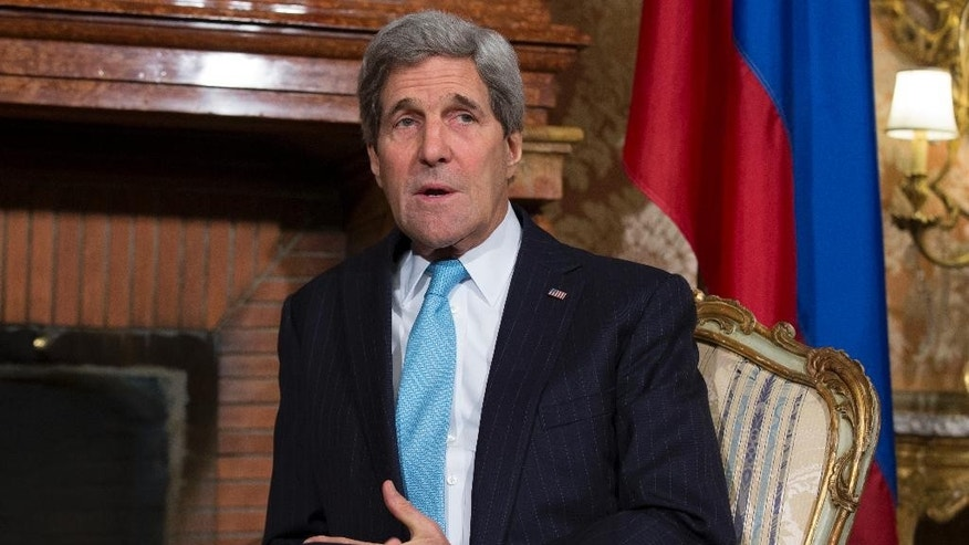 US Secretary of State John Kerry talks before meeting with Russian Foreign Minister Sergei Lavrov at Villa Taverna, on Sunday, Dec. 14, 2014, in Rome. Kerry and Lavrov discussed the ongoing Middle East peace process, and rising tensions in Ukraine. (AP Photo/Evan Vucci, Pool)