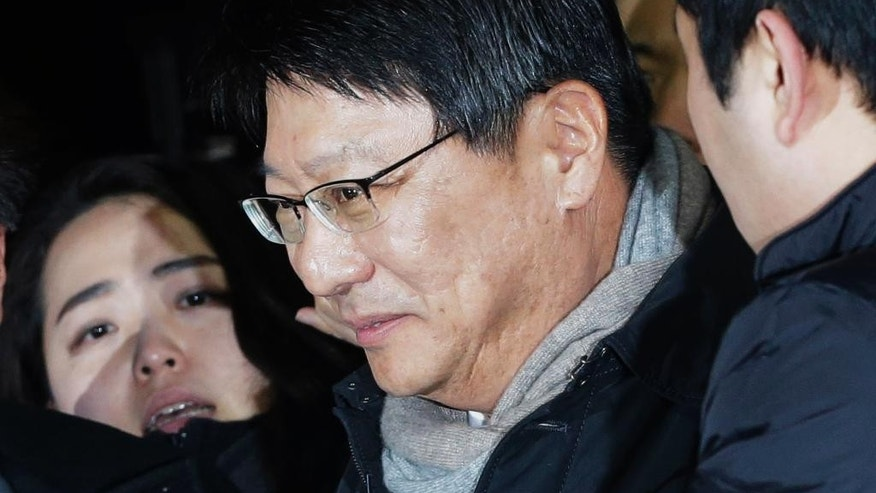 Park Ji-man, South Korean President Park Geun-hye's brother, arrives at Seoul District Prosecutors' Office in Seoul, South Korea, Monday, Dec. 15, 2014. Prosecutors hauled in Park for questioning, the latest in a slew of high-profile figures who have been summoned since a local newspaper first reported the speculation late last month.(AP Photo/Ahn Young-joon)