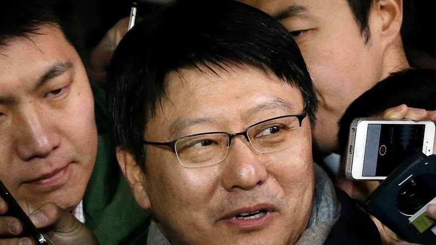 Park Ji-man, South Korean President Park Geun-hye's brother, talks to the media upon his arrival at Seoul District Prosecutors' Office in Seoul, South Korea, Monday, Dec. 15, 2014. Prosecutors hauled in Park for questioning, the latest in a slew of high-profile figures who have been summoned since a local newspaper first reported the speculation late last month. (AP Photo/Ahn Young-joon)