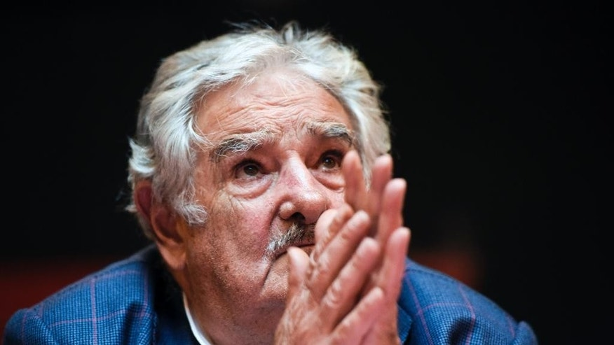 Uruguay's President Jose Mujica looks up during a press conference at the workers union PIT-CNT in Montevideo, Uruguay, Tuesday, Dec. 16, 2014. Mujica says the United States has guaranteed that six former Guantanamo Bay prisoners who arrived in Uruguay as refugees are not terrorists. The six men are free and staying at a Montevideo house as guests of a major labor union. (AP Photo/Matilde Campodonico)