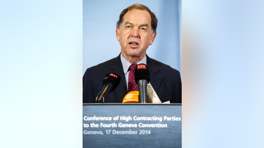 Swiss Ambassador and chairman Paul Fivat speaks to the media during a press conference following the Conference of High Contracting Parties to the Fourth Geneva Convention, in Geneva, Switzerland, Wednesday, Dec. 17, 2014. A declaration adopted by consensus among 126 parties to the Fourth Geneva Convention insists that international humanitarian law must be followed _ and all serious violations investigated _ in areas affected by the conflict between Israel and the Palestinians.  (AP Photo/Keystone, Salvatore Di Nolfi)