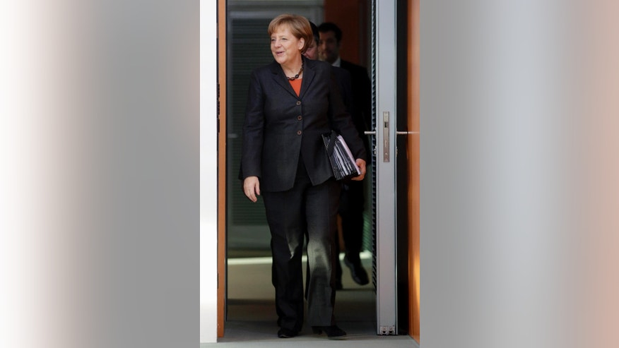German Chancellor Angela Merkel arrives for the weekly cabinet meeting at the chancellery in Berlin, Germany, Wednesday, Dec. 17, 2014. (AP Photo/Michael Sohn)