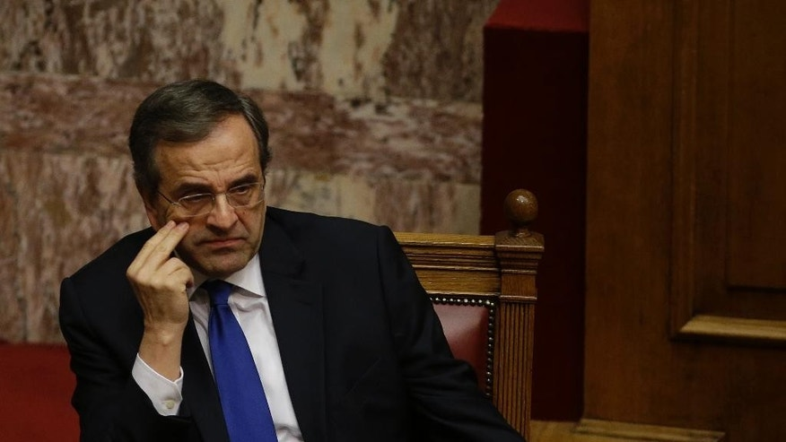Greece's Prime Minister Antonis Samaras attends the first round of voting to elect a new Greek president at the Parliament in Athens, Wednesday, Dec. 17, 2014. Parliament has failed to elect a new Greek president in the first round of voting, leaving another two tries before the government falls and early elections have to be called. The conservative-led government's candidate, former European Commissioner Stavros Dimas, received 160 votes Wednesday, far short of the 200 needed for an outright win. (AP Photo/Thanassis Stavrakis)