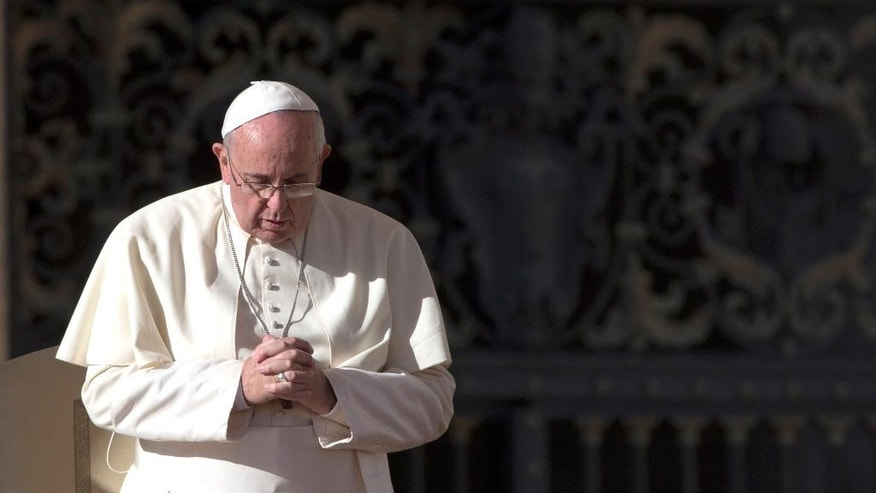 Pope Francis prays at the end of his weekly general audience in St. Peter's Square at the Vatican, Wednesday, Dec. 17, 2014. (AP Photo/Alessandra Tarantino)