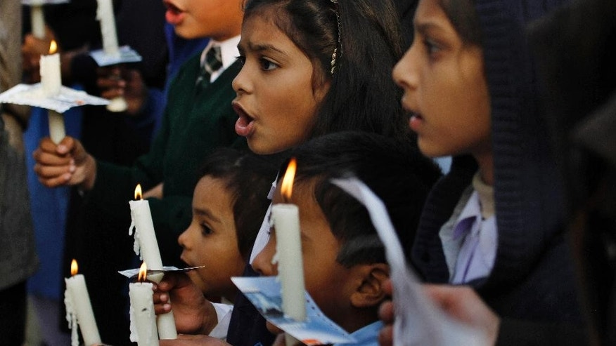 Pakistani children from a Christian community shout slogans to condemn Tuesday's Taliban attack on a military-run school in Peshawar, as they join a demonstration Wednesday, Dec. 17, 2014 in Islamabad, Pakistan. Pakistan mourned as the nation prepares for mass funerals Wednesday for over 140 people, most of them children, killed in the Taliban massacre in a military-run school in the country's northwest in the deadliest and most horrific attacks in years, officials said. (AP Photo/Anjum Naveed)