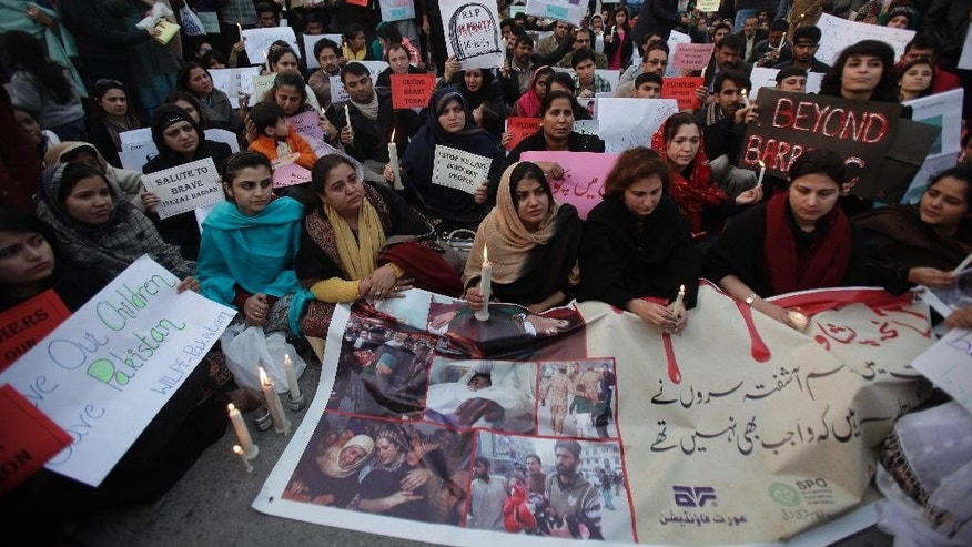 Members of a civil society and non-government organizations (NGO's) take part in a demonstration to condemn Tuesday's Taliban attack on a military-run school in Islamabad, Pakistan, Wednesday, Dec. 17, 2014. Pakistan mourned as the nation prepares for mass funerals Wednesday for over 140 people, most of them children, killed in the Taliban massacre in a military-run school in the country's northwest in the deadliest and most horrific attacks in years, officials said. (AP Photo/Anjum Naveed)