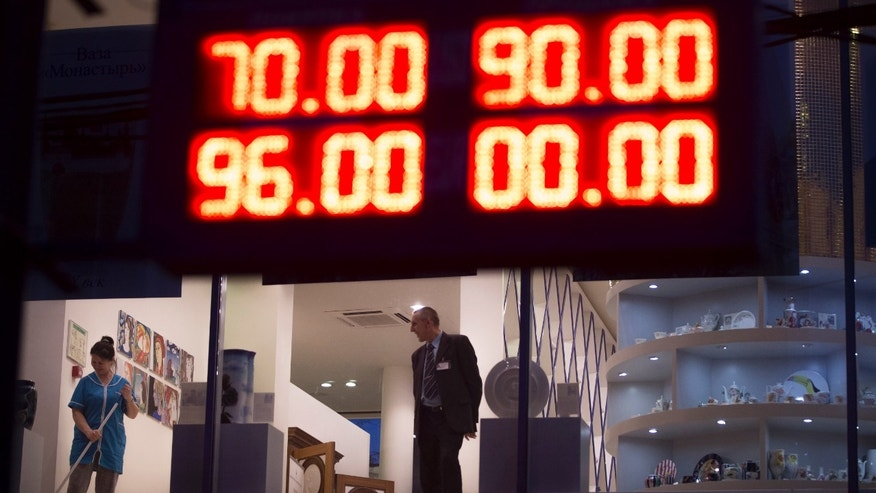 Dec. 16, 2014: An electronic board shows exchange rates for the Dollar, top, and the Euro, bottom, next to a luxury St. Petersburg china's shop in Moscow, Russia.
