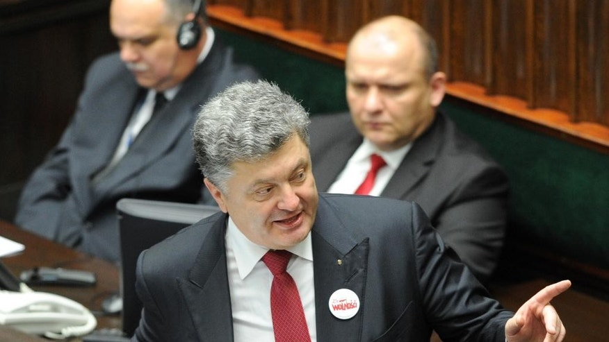 Ukrainian President Petro Poroshenko addresses lawmakers  at the Polish parliament in Warsaw, Poland, Wednesday, Dec. 17, 2014, on the first day of his official visit to Poland. (AP Photo/Alik Keplicz)