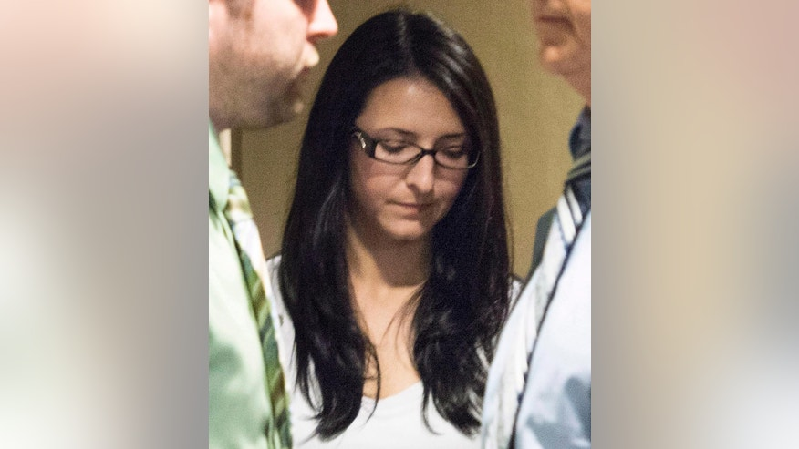 FILE - In this June 3, 2014, file photo, Emma Czornobaj appears at the Montreal Courthouse in Montreal. Czornobaj, who caused a fatal traffic accident after stopping her car to help ducks on a busy highway, was sentenced Thursday, Dec. 18, 2014, to 90 days in prison and a 10-year driving ban. (AP Photo/The Canadian Press, Graham Hughes, File)