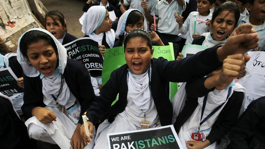 Pakistani schoolgirls chant slogans during a protest to condemn Tuesday's Taliban attack on a military-run school in Peshawar, in Karachi, Pakistan, Friday, Dec. 19, 2014. Pakistani jets and ground forces killed 67 militants in a northwestern tribal region near the Afghan border, officials said Friday, days after Taliban fighters killed 148 people — most of them children — in a school massacre. (AP Photo/Fareed Khan)