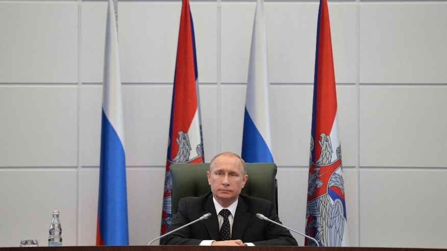 Russian President Vladimir Putin heads a meeting with senior military officials at the Defense Ministry's control room in Moscow, Russia on Friday, Dec. 19, 2014. (AP Photo/RIA Novosti, Alexei Druzhinin, Presidential Press Service)