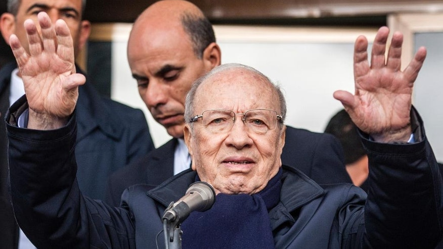 Beji Caid Essebsi, 88, a minister and parliamentary speaker under previous presidents, waves during a campaign speech in the region of Kef, north of Tunis, Tunisia, Wednesday, Dec.17, 2014. The runoff pits Caid Essebsi against outgoing interim president Moncef Marzouki, a veteran rights activist for Dec.21 second round of the presidential elections. (AP Photo/Ilyess Osmane)