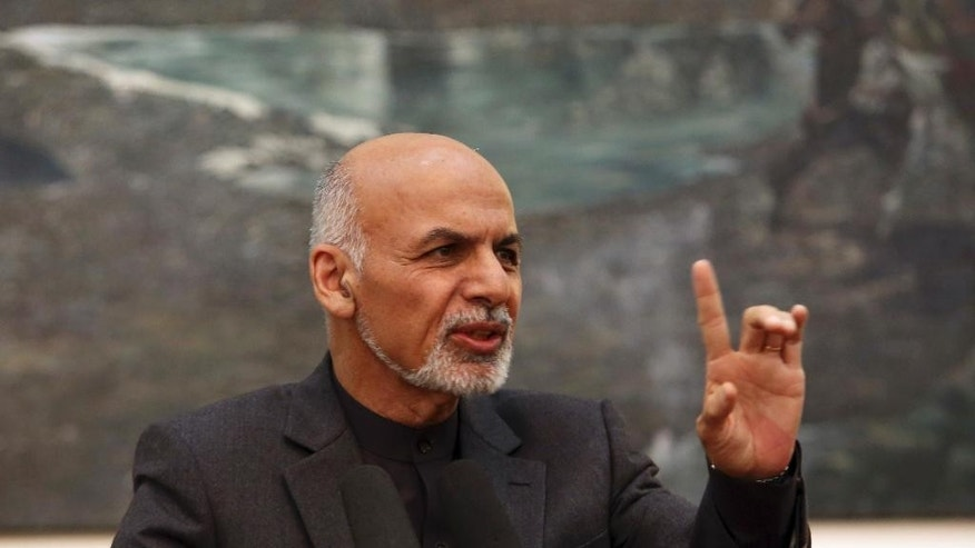 In this photo taken Saturday, Dec. 6, 2014, Afghan President Ashraf Ghani speaks during a joint news conference in Kabul, Afghanistan. Ghani has promised a complete overhaul of Afghanistan's government to root out corruption and incompetence, but after three months in office, three missed deadlines and countless promises, he and his election rival-turned-deputy have yet to appoint a single Cabinet minister. (AP Photo/Rahmat Gul)