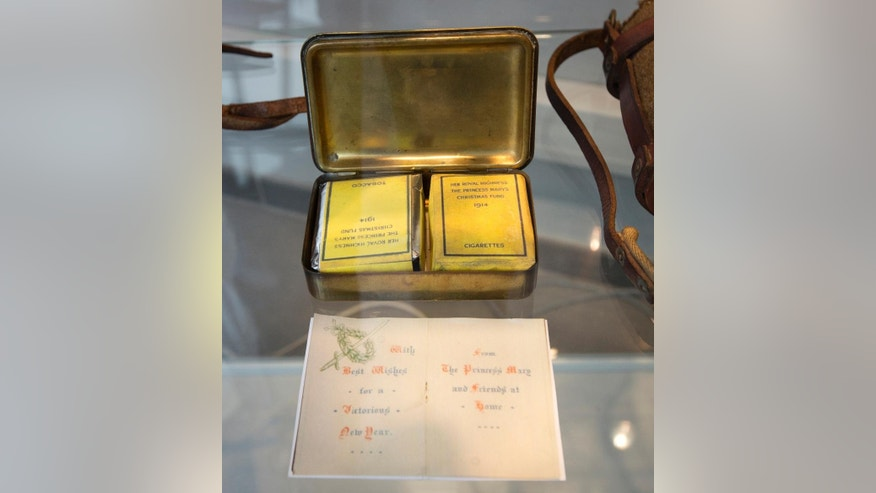 In this photo taken on Nov. 21, 2014, a Princess Mary Christmas tin from 1914 on display at the Plugstreet 14-18 Experience museum in Ploegsteert, Belgium. The gift boxes were given to soldiers during Christmas of 1914. The tins contained a package of cigarettes, a Christmas card and a photo of Princess Mary. Soldiers who had been killing each other by the tens of thousands for months climbed out of their soggy trenches to seek a shred of humanity amid the horrors of World War I. Hands reached out across the divide and in Flanders Fields a century ago, a spontaneous Christmas truce ever so briefly lifted the human spirit. (AP Photo/Virginia Mayo)