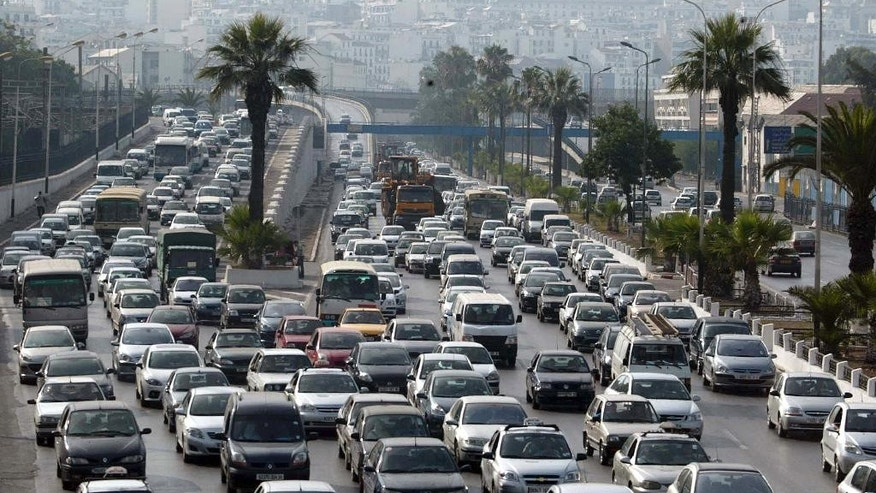 This Sept. 29, 2010 photo shows a traffic jam in Algiers, Algeria. With oil prices at their lowest in five years, North Africa's hydrocarbon giant Algeria is feeling the pinch and may have to re-examine generous and massive public spending to confront social unrest. (AP Photo/Anis Belghoul)
