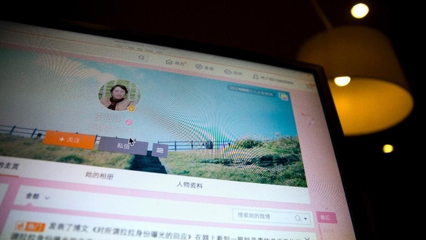 A blog by China's top sexologist, Li Yinhe revealing that she has been living with a transgender man for 17 years is displayed on a computer screen in Beijing, China, Saturday, Dec. 20, 2014. The blog by Li, also widow of the well-known Chinese author Wang Xiaobo, was read more than 200,000 times within 24 hours, and it became a hot topic on China's microblogging service Weibo with nearly 3 million hits, as her blog spurred spirited discussions on China social media not only about her nonconventional relationship, but also about transgender Chinese in general. (AP Photo/Ng Han Guan)