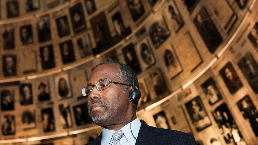 "In this Thursday, Dec. 18, 2014 photo, Ben Carson visits Yad Vashem Holocaust memorial in Jerusalem. Carson, 63, a retired African-American neurosurgeon best known for his groundbreaking work in separating conjoined twins, has not yet declared his candidacy for the Republican Presidential nomination, saying that he is ""strongly considering"" a bid. (AP Photo/Dan Balilty)"