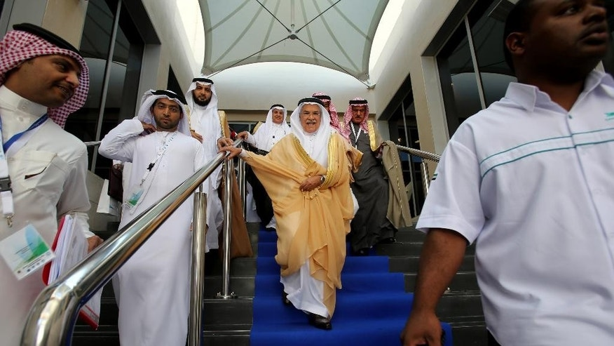 Saudi Arabia's Minister of Petroleum and Mineral Resources Ali Ibrahim Naimi leaves the hall during the opening day of the 10th Arab energy Conference in Abu Dhabi, United Arab Emirates, Sunday, Dec. 21, 2014. (AP Photo/Kamran Jebreili)