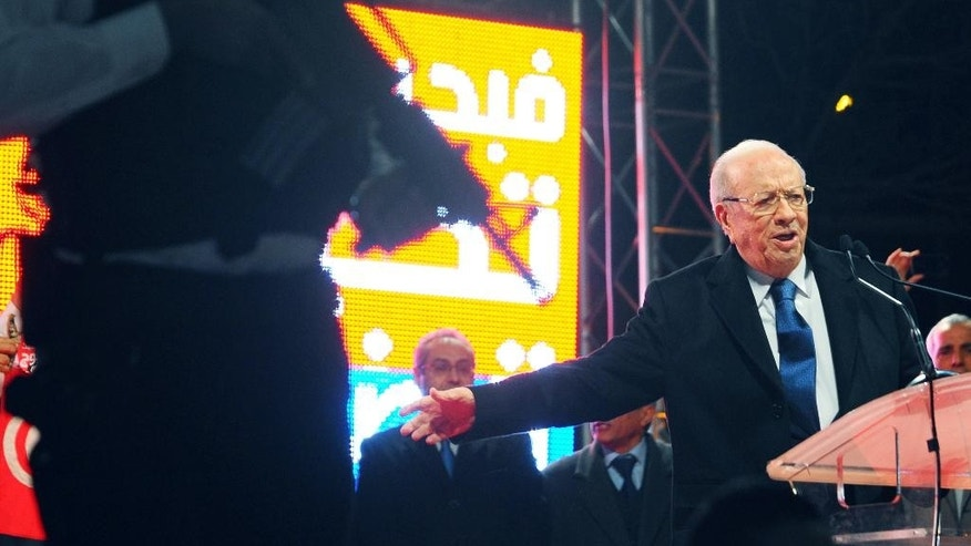 Tunisian presidential candidate Beji Caid Essebsi , right, delivers his speech during his last campaign rally in Tunis, Friday, Dec. 19, 2014. Tunisians must decide Sunday between Beji Caid Essebsi, an 88-year-old veteran of previous regimes, and Moncef Marzouki, a 75-year-old human rights activist who is the outgoing interim president. For the third time in just two months, Tunisian voters will head to the polls this weekend, this time to elect a president in a runoff vote that presents a stark choice between the country's past and its Arab Spring revolution. (AP Photo/Hassene Dridi)