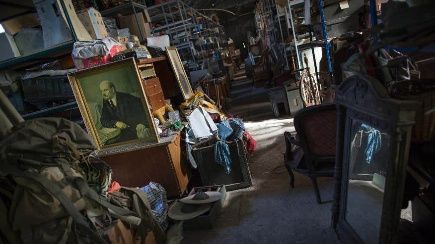 In this photo taken on Wednesday, Oct.  29, 2014,  a warehouse full of movie set props. Yalta Film Studios is one of dozens of businesses to be forcibly taken over this year since Crimea's new pro-Moscow leaders came to power in March. (AP Photo/Alexander Zemlianichenko)