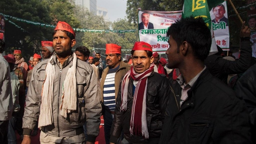 Samajwadi Party supporters participate in an anti government protest in New Delhi, India, Monday, Dec. 22, 2014. The protesters voiced their disapproval for right wing Hindu groups allied to the ruling Bharatiya Janata Party conducting a series of ceremonies across India over the past week to convert Christians and Muslims to Hinduism. (AP Photo/Tsering Topgyal)