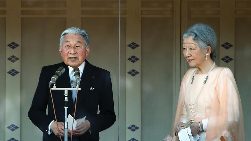 Japan's Emperor Akihito, left, accompanied by his wife Empress Michiko, right, delivers a speech to well-wishers as they appear on the balcony of the Imperial Palace, marking his 81th birthday in Tokyo, Tuesday, Dec. 23, 2014. (AP Photo/Eugene Hoshiko)