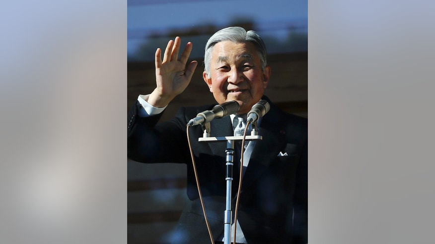 """Japan's Emperor Akihito waves to well-wishers as he and family members appear on the balcony of the Imperial Palace during the emperor's 81th birthday in Tokyo, Tuesday, Dec. 23, 2014. Akihito says he """"ardently"""" hoped Japan will strive hard as a peaceful country, as he celebrated his 81th birthday ahead of the 70th anniversary of the end of World War II next year. (AP Photo/Eugene Hoshiko)"""