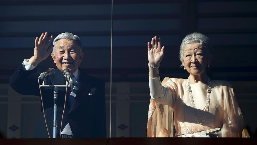 Japan's Emperor Akihito, left, accompanied by his wife Empress Michiko, right, wave at well-wishers as they appear on the balcony of the Imperial Palace to mark the emperor's 81th birthday in Tokyo, Tuesday, Dec. 23, 2014. (AP Photo/Eugene Hoshiko)