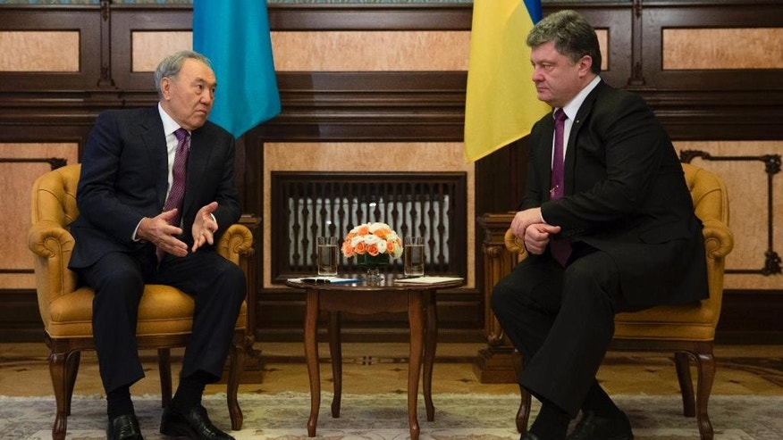 Kazakh President Nursultan Nazarbayev, left, speaks to the Ukrainian President Petro Poroshenko during their meeting in Kiev, Ukraine, Monday, Dec. 22, 2014. (AP Photo/Mikhail Palinchak, Pool)