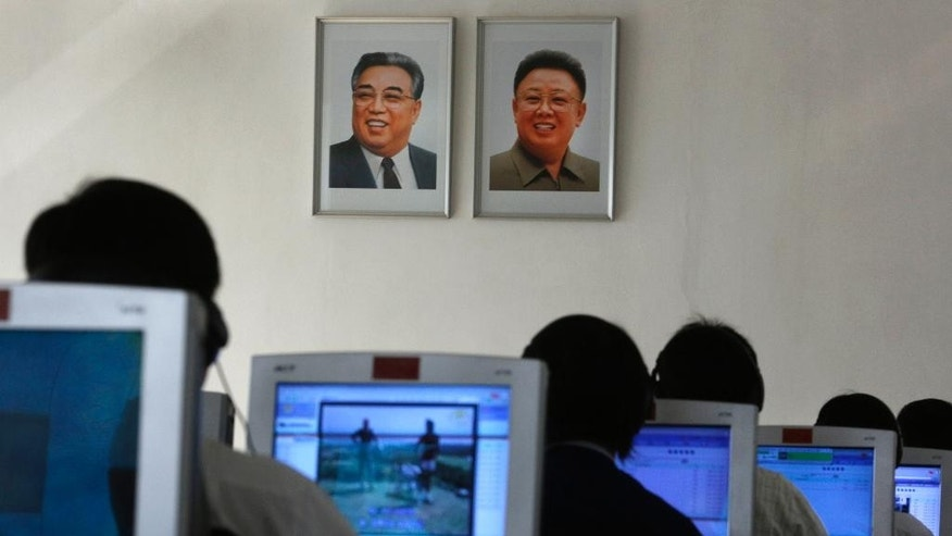 FILE - In this Thursday, Sept. 20, 2012 file photo, North Korean students use computers in a classroom with portraits of the country's later leaders Kim Il Sung, left, and his son Kim Jong Il hanging on the wall at the Kim Chaek University of Technology in Pyongyang, North Korea. Key North Korean websites were back online Tuesday, Dec. 23, 2014 after an hours-long shutdown that followed a U.S. vow to respond to a cyberattack on Sony Pictures that Washington blames on Pyongyang. (AP Photo/Vincent Yu, File)