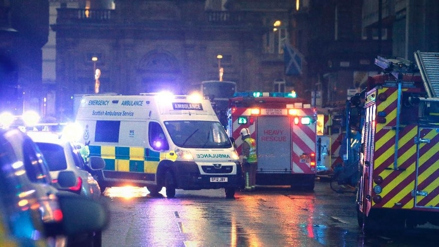"Emergency services attend the scene in  George Square in Glasgow Scotland  after it is understood a garbage truck, rear right,  crashed into a group of pedestrians Monday Dec. 22, 2014. Police say an ""ongoing serious incident"" is unfolding in the city centre of Glasgow in Scotland. Emergency services responded Monday to reports that a truck has crashed into a group of pedestrians. The incident happened near George Square in the central part of the city. Surrounding roads have been closed. Police weren't immediately able to give further details about the situation. (AP Photo/Danny Lawson/PA) UNITED KINGDOM OUT"