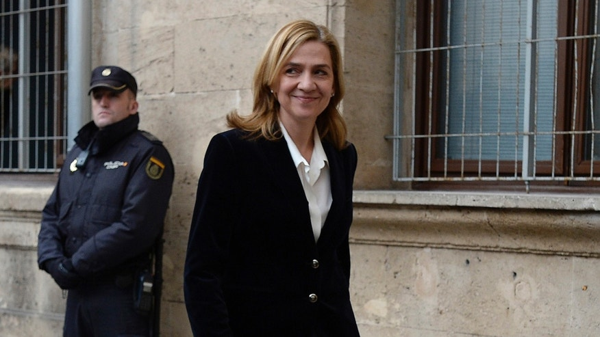 FILE - In this Feb. 8, 2014 file photo, Spain's Princess Cristina arrives at the courthouse of Palma de Mallorca in Palma Mallorca, Spain. A Spanish judge on Monday Dec. 22, 2014 has ordered Princess Cristina to be tried along with her husband on charges of tax fraud, marking the first time that a member of the countryâs royal family heads to court since the royalty was restored in 1975. The legal troubles of King Felipe VIâs sister during a four-year probe have damaged the Spanish monarchy's image. (AP Photo/Manu Fernandez, File)