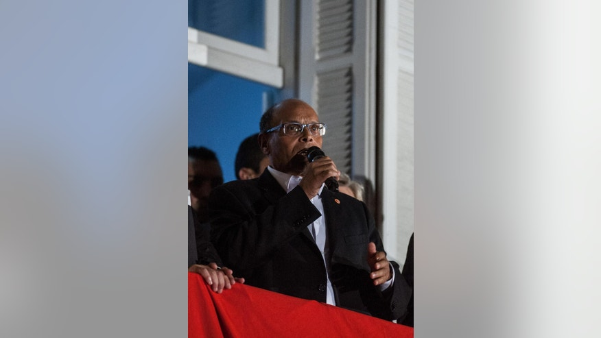 Tunisian presidential candidate Moncef Marzouki gives a speech, after the second round of the country's presidential election, in Tunis, Sunday, Dec. 21, 2014. Tunisian polling firms have declared Beji Caid Essebsi, an 88-year-old official from previous regimes, as the winner of Sunday's presidential runoff, cementing his dominance over a country where his party already controls Parliament. (AP Photo/Ilyess Osmane)