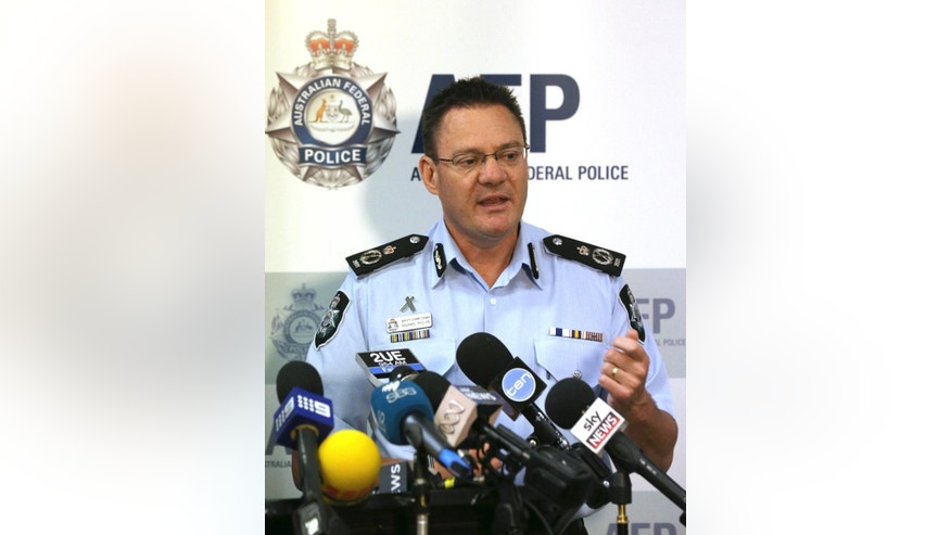 Australian Federal Police Deputy Commissioner Michael Phelan speaks to the media that two Sydney men have been arrested by the Joint Counter Terrorism team in Sydney, Australia, Wednesday, Dec. 24, 2014. Phelan said there was no specific terrorist threat and the arrests were related to an ongoing counterterrorism operation that led to a series of raids in Sydney in September. (AP Photo/Rob Griffith)