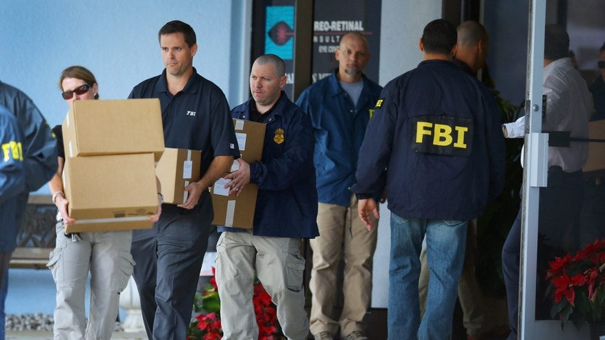 WEST PALM BEACH, FL - JANUARY 30:  FBI agents carry out boxes as law enforcement officials investigate the medical-office complex of Dr. Salomon Melgen who has possible ties to U.S. Sen. Bob Menendez (D-NJ) on January 30, 2013 in West Palm Beach, Florida. The agents arrived last night at the medical-office complex and started hauling away potential evidence in several vans.  (Photo by Joe Raedle/Getty Images)