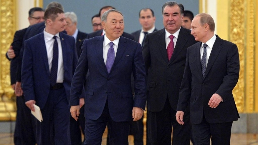 From foreground left: Kazakhstan's President Nursultan Nazarbayev, Tajikistan's President Emomali Rakhmon and Russian President Vladimir Putin walk during a meeting of CSTO (Collective Security Treaty Organization) in Moscow's Kremlin, Russia, Tuesday, Dec. 23, 2014.(AP Photo/RIA Novosti, Alexei Druzhinin, Presidential Press Service)