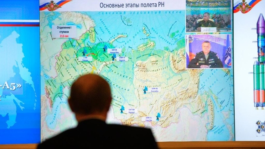 Russian President Vladimir Putin watches a launch of Angara-A5 rocket booster at Plesetsk Cosmodrome by live video link in Moscow, Russia, on Tuesday, Dec. 23, 2014. (AP Photo/RIA Novosti, Alexei Druzhinin, Presidential Press Service)
