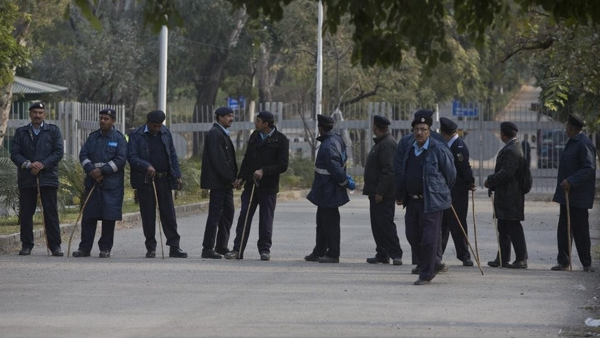Security is beefed up outside the prime minister house during a meeting of all political parties and the military leadership to hash out new counter-terrorism policies, in Islamabad, Pakistan, Wednesday, Dec. 24, 2014. Pakistan's prime minister says the country will set up special trial courts under the supervision of military officers to prosecute terrorism cases in the wake of the Taliban school massacre. (AP Photo/B.K. Bangash)
