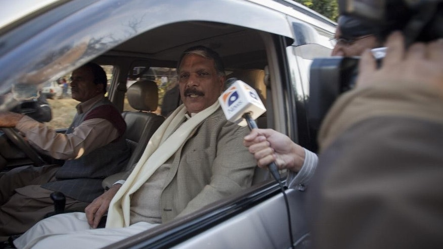 Journalists chase Pakistani lawmaker Ijazul Haq who left after attending a meeting of all political parties and the military leadership to hash out new counter-terrorism policies, in Islamabad, Pakistan, Wednesday, Dec. 24, 2014. Pakistan's prime minister says the country will set up special trial courts under the supervision of military officers to prosecute terrorism cases in the wake of the Taliban school massacre. (AP Photo/B.K. Bangash)