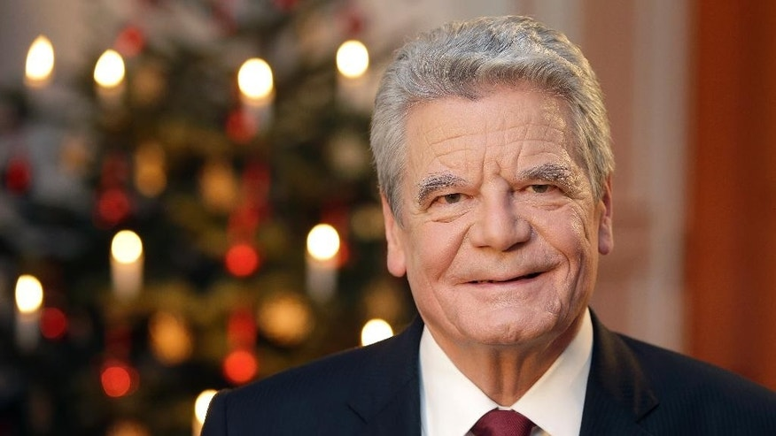 In this Monday Dec. 22, 2014 picture,  German President Joachim Gauck poses after the recording of the traditional Christmas message at Bellevue Palace in Berlin.  With the speech, the head of state addresses the citizens during the Christmas celebrations. (AP Photo/Michael Sohn, pool)