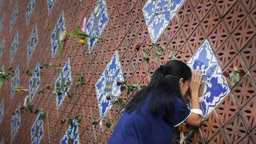 A woman offers prayers on a tiled memorial wall displaying names of victims from the Asian tsunami, in Phang Nga, Ban Nam Khem province, Thailand, Friday, Dec. 26, 2014. December 26 marks the 10th anniversary of one of the deadliest natural disasters in world history: a tsunami, triggered by a massive earthquake off the Indonesian coast, that left more than 230,000 people dead in 14 countries and caused about $10 billion in damage. (AP Photo/Wong Maye-E)
