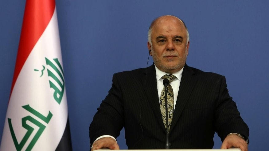 Iraqi Prime Minister Haider al-Abadi speaks to the media during a joint news conference with his Turkish counterpart Ahmet Davutoglu after their talks in Ankara, Turkey, Thursday, Dec. 25, 2014.(AP Photo)