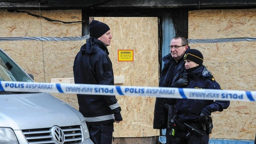 Police investigators  stand  outside a cellar mosque after a fire, in Eskilstuna, Sweden, Friday,  Dec.  26, 2014. Police in Sweden say one mosque has been vandalized and a second mosque in the same town set ablaze by a suspected arsonist, leaving at least five people injured. Police said Friday the two attacks in the central Swedish town of Eskilstuna took place within hours of each other Thursday and early Friday. They said 20 people were inside the mosque when the blaze broke out. Two of the injured were treated for smoke inhalation, while the others had minor injuries. (AP Photo /TT, Pontus Stenberg)  SWEDEN OUT