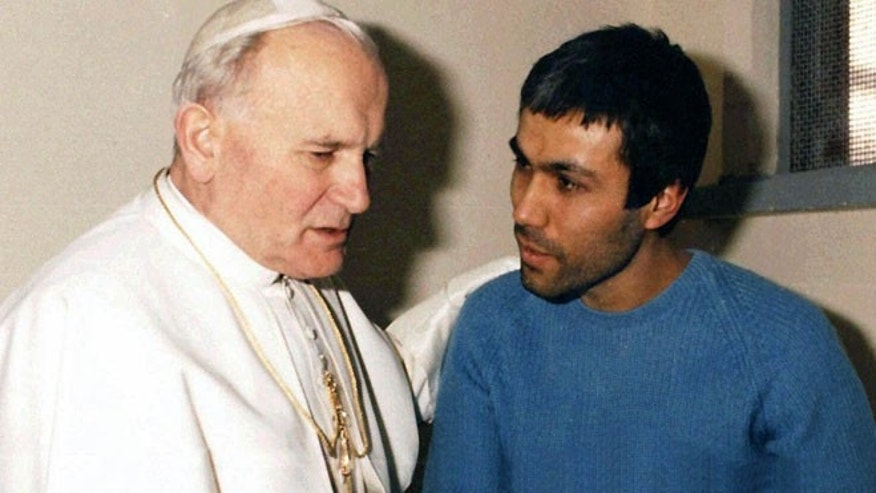 Dec. 27, 1983: In this file photo provided by Vatican newspaper L'Osservatore Romano, Pope John Paul II, left, meets Mehmet Ali Agca, in Agca's prison cell in Rome. (AP)