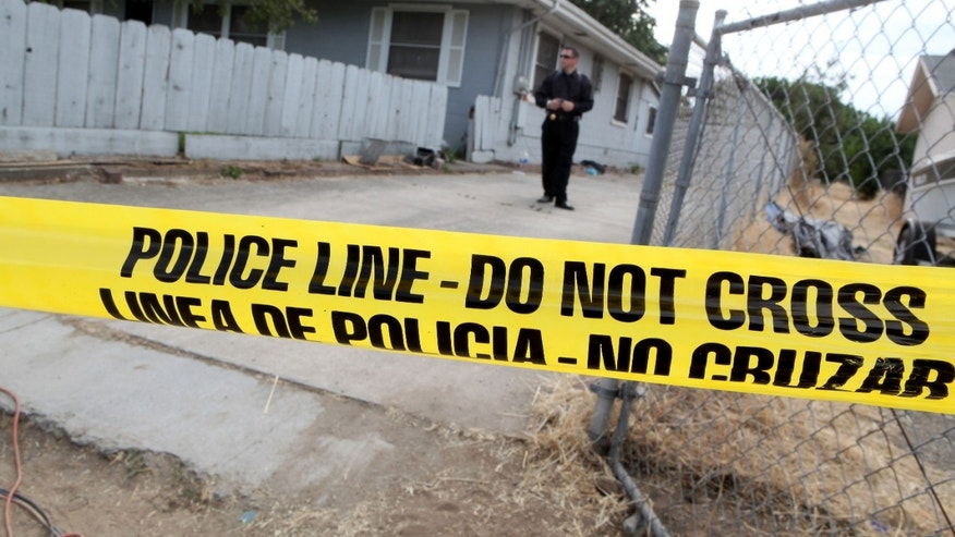 ANTIOCH, CA - AUGUST 28:  Yellow police tape is stretched across the front of the home of alleged kidnapper Phillip Garrido as they search the property August 28, 2009 in Antioch, California. Jaycee Lee Dugard was allegedly kidnapped by Phillip Garrido nearly two decades ago and was forced to live in tents and sheds behind Garrido's home with two of her children that were fathered by Garrido. Pittsburg police are also searching Garrido's home for evidence linking him to the murders of prostitutes in the 1990's. (Photo by Justin Sullivan/Getty Images)