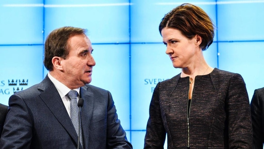 Sweden's Prime Minister and Social Democratic Party leader Stefan Löfven, left, and Moderate Party leader-elect Anna Kinberg Batra speak during a press conference at the Swedish Parliament in Stockholm, Sweden, Saturday, Dec. 27, 2014. During the presser the parties announced that a 'December agreement' on how to rule with a minority government in the parliament, has canceled the plans to run a snap election in March 2015.  (AP Photo / Henrik Montgomery / TT)  SWEDEN OUT